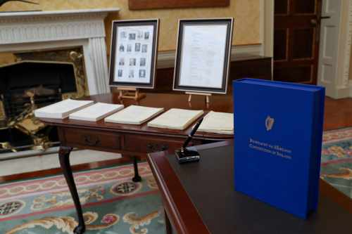 President signs text of Bunreacht na hÉireann in accordance with Article 25 of the Constitution