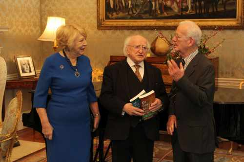 President and Sabina receive Dom Colbert who will present a copy of his books 'An Irish Doctor's Odyssey - The Saints Are in Heaven' and 'No Tears Left - Biafra to Bosnia'
