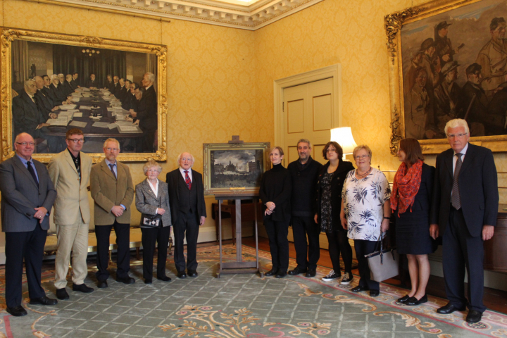 The family of the late Mr. Joseph McGill view the painting of 'The Church Street Barricades, 1916'
