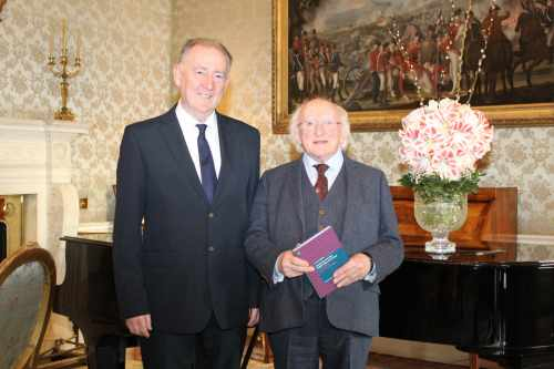 "President receives Mr. Vic Merriman who presents a copy of his book ""Austerity and the Public Role of Drama Performing Lives-in-Common"""