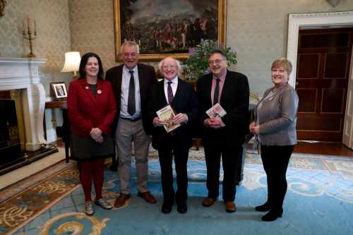 President receives Director of Limerick Writers Centre Dominic Taylor who presents their publication on the Limerick Soviet Centenary