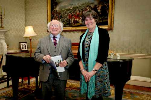 "President receives Dr. Ríonach Uí Ógáin and group for a presentation of book ""Life, lore and song / 'Binneas an tSiansa'"""