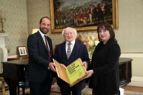 "President receives representatives from GMIT Letterfrack who present a copy of their book ""See the Wood from the Trees"""