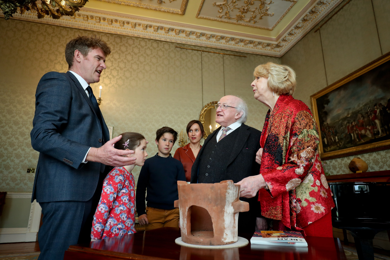 President receives Mr. Conor Fox who presents an Alfred Chisale stove from Malawi