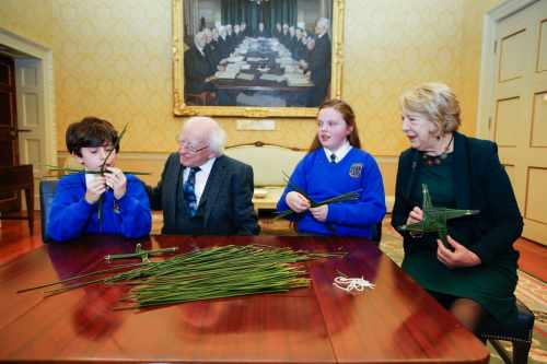 Children from St. Brigid's Primary School present St Brigid's Cross to President and Sabina